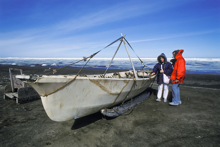 Tourists examine a traditional whaling boat near the Arctic Ocean during a summer visit to Barrow, Alaska