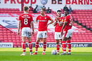 Cameron McGeehan of Barnsley (8), Cauley Woodrow of Barnsley (9), Alex Mowatt of Barnsley (27) and Mamadou Thiam of Barnsley (26) stand over a free kick during the EFL Sky Bet League 1 match between Barnsley and Coventry City at Oakwell, Barnsley, England on 30 March 2019.
