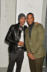 Left to right, MANNY LANGLEY and REGGIE YATES at the Audemars Piguet Royal Oak Offshore 42mm Party held at Victoria House, Bloomsbury Square, London on 23rd April 2014.