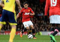 Manchester United's Shinji Kagawa (C) runs with the ball during the match against Sunderland