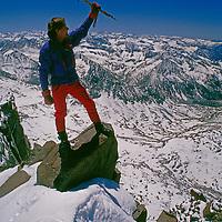 Kings Canyon National Park, California. Mountaineer atop Polemonium Peak in the Sierra Nevada.