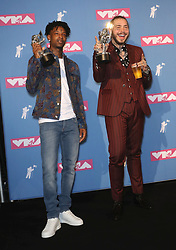 August 21, 2018 - New York City, New York, USA - 8/20/18.21 Savage and Post Malone pose with their award for song of the year for ''Rockstar'' in the press room at the 2018 MTV Video Music Awards held at Radio City Music Hall in New York City..(NYC) (Credit Image: © Starmax/Newscom via ZUMA Press)