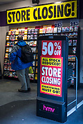 A sale sign at the shop entrance of an HMV music store near Bank, central London, United Kingdom. Due to the economic crisis in Britain the British entertainment retailing company entered into administration in January 23013. All stock is reduced as everything must go.