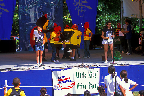 Stock photo of young children making a presentation on stage at the International Festival in downtown Houston Texas