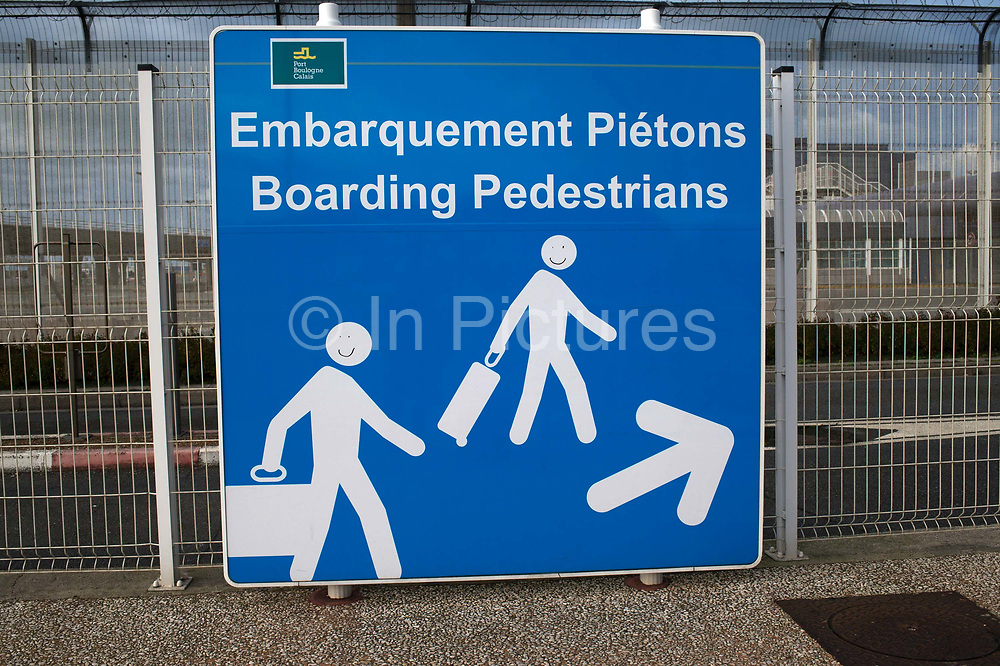 France. Calais. Sign for pedestrian boarding for Channel ferry, with smiley faces drawn on the people symbols.