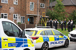 © Licensed to London News Pictures 30/08/2021. <br /> London, UK, Police outside a block of flats. Armed police are on scene after reports of a stabbing in Orpington, South East London. A large number of police remain in the area as a section 60 is in place. Police have made several arrests and an ambulance is also in attendance. Photo credit:Grant Falvey/LNP