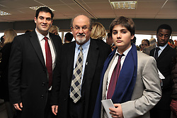 Left to right, ZAFAR RUSHDIE, SIR SALMAN RUSHDIE and MILAN RUSHDIE at the Hennessy Gold Cup at Newbury Racecourse, Berkshire on 26th November 2011.