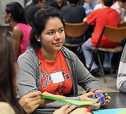An Early College HS senior listens to another college-bound student at the Senior Summit on Tuesday, May 14, 2013.