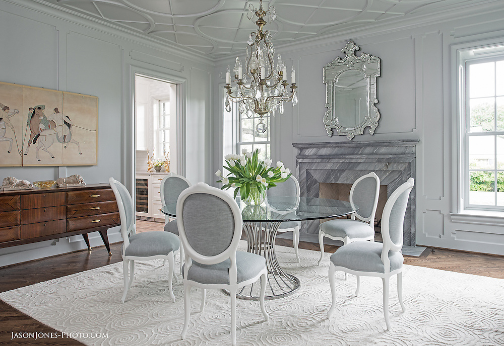 Formal dining room with fireplace, chandelier, and imported rug