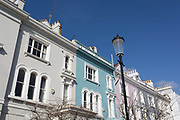 Victorian houses along Elgin Crescent W11 in Notting Hill, on 13th March 2018, in London, England. Elgin Crescents houses were built in the 1850s and 1860s with many now listed buildings. East of Ladbroke Grove, it was originally called Elgin Road. It is named after the town of Elgin in Scotland.