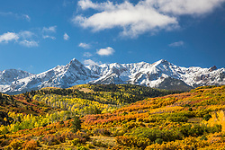 Autumn at beautiful Dallas Divide in the San Juan Mountains of Southwest Colorado. A splash of white from an early snow always adds a bit of splash to autumn in Colorado.