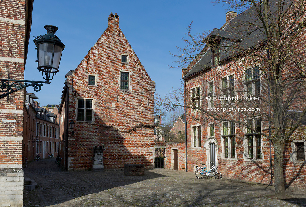 The protected UNESCO World heritage Site at the Grand Beguinage in the historic city of Leuven, on 24th March 2017, in Belgium. The Grand Béguinage of Leuven, or in Dutch Groot Begijnhof van Leuven is a well preserved and completely restored historical quarter containing a dozen streets south of the city. About 3 hectares (7.5 acres) in size, with some 300 apartments in almost 100 houses, it is one of the largest remaining béguinages in the Low Countries. Founded in 1232, it was a community for women (Beguines), widows or spinsters wishing for a religious but independent life. It is now an area for professors, students and staff of Leuven University.