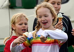 Savannah Phillips and Isla Phillips enjoying ice creams during the Land Rover Novice & Intermediate Horse Trials at Gatcombe Park on March 23, 2019.