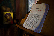 Dogeared Greek bible in the 10th century Byzantine chapel of Agios Stefanos, Drakona, Crete, Greece