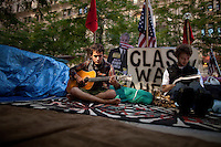 Kavy Merica of the Penn Comrads Collective (name of band), left, and Ellis Roberts in Zuccotti Park during the  Occupy Wall Street Protest in New York...Photo by Robert Caplin.