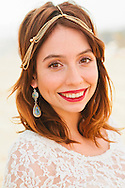 Portrait of a pretty brunette woman at the beach.