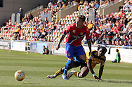 Dagenham's Matt Partridge challenges for the ball with Newport's David Tutonda (r). Skybet football league two match , Newport county v Dagenham & Redbridge at Rodney Parade in Newport, South Wales on Saturday 18th April 2015.<br /> pic by David Richards, Andrew Orchard sports photography.
