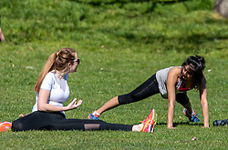 © Licensed to London News Pictures. 05/04/2020. London, UK. Two young women exercise in the warm weather. Members of the public come out to exercise In Hyde Park as temperatures reach over 21c this weekend. Hyde Park was busy with walkers, runners and cyclists as the Government urged the public not to leave home during the fine weather as the Coronavirus crisis continues. Photo credit: Alex Lentati/LNP