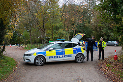© Licensed to London News Pictures. 24/10/2020. Watlington Hill, UK. A police vehicle forms a cordon to a carpark at the Watlington Hill National Trust Estate. A murder investigation has been launched by Thames Valley Police after the body of a woman in her sixties was located in woodland in the Watlington Hill National Trust Estate at approximatly 5:53pm on Friday 23/10/2020. Photo credit: Peter Manning/LNP