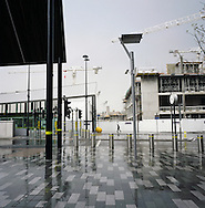 A lone figure walking past he Paradise Project retail, leisure and housing development on the Mersey waterfront in Liverpool. The Mersey is a river in north west England which stretches for 70 miles (112 km) from Stockport, Greater Manchester, ending at Liverpool Bay, Merseyside. For centuries, it formed part of the ancient county divide between Lancashire and Cheshire.