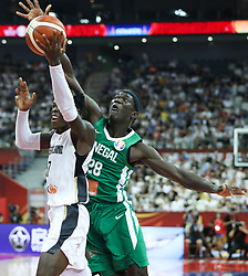 SHANGHAI, Sept. 7, 2019  Ibrahima Faye (R) of Senegal defends Dennis Schroder of Germany during the group P match between Germany and Senegal at the 2019 FIBA World Cup in Shanghai, east China, on Sept. 7, 2019.  (Credit Image: RealTime Images)