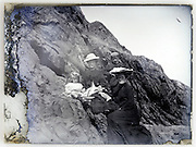 fading glass plate with family posing on rocks