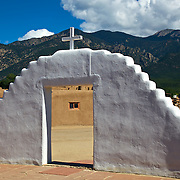 San Geronimo Chapel looking towards the Sangre de Christo Mountains at Taos Peublo, the oldest living Native American community designated both a World Heritage Site by UNESCO and a National Historic Landmark.