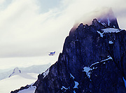 Wings of Alaska Cessna 206 flying past nunataks of the Coast Range rising above the Juneau Icefield, Tongass National Forest, Southeast Alaska.