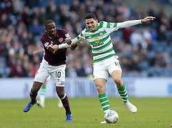 Heart of Midlothian's Arnaud Djoum battle for the ball with Celtic's Tom Rogic (L) during the Betfred Cup semi final match at BT Murrayfield Stadium, Edinburgh.