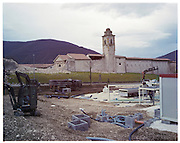 Norcia. What was the historic centre is now inaccessible and the city walls collapsed in several points. Just in front of the St. Anthony Monastery, right after the walls, there is a large open space where the army is positioning some housing units.