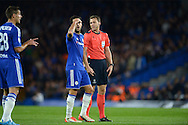 Cesc Fabregas of Chelsea reacts as Referee Felix Zwayer of Germany does not book Nosa Igiebor of Maccabi Tel Aviv for fouling Eden Hazard of Chelsea. UEFA Champions League group G match, Chelsea v Maccabi Tel Aviv at Stamford Bridge in London on Wednesday 16th September 2015.<br /> pic by John Patrick Fletcher, Andrew Orchard sports photography.