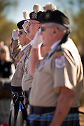 09 DECEMBER 2011 - PHOENIX, AZ:  Members of the Scottish American Military Society salute during a wreath laying ceremony in Phoenix Saturday. Several hundred volunteers and veterans gathered at the National Memorial Cemetery of Arizona in Phoenix Saturday to lay Christmas wreaths on headstones, a tradition started by Wreaths Across America. Wreaths Across America is a nonprofit organization founded to continue and expand the annual wreath laying ceremony at Arlington National Cemetery begun by Maine businessman, Morrill Worcester, in 1992.   PHOTO BY JACK KURTZ