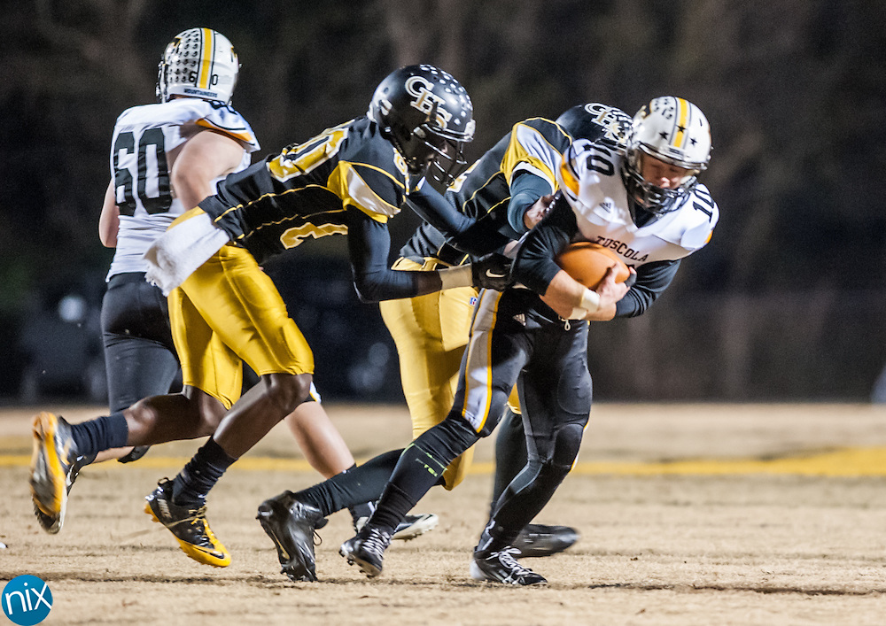 Concord defenders bring down Tuscola's Nathan Messer (10) in the first round of the NCHSAA playoffs Friday night at Concord High School. Concord won the game 49-7