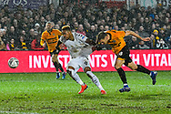 Britt Assombalonga (9) of Middlesbrough has his shirt pulled by Mickey Demetriou of (28) of Newport County during the The FA Cup match between Newport County and Middlesbrough at Rodney Parade, Newport, Wales on 5 February 2019.