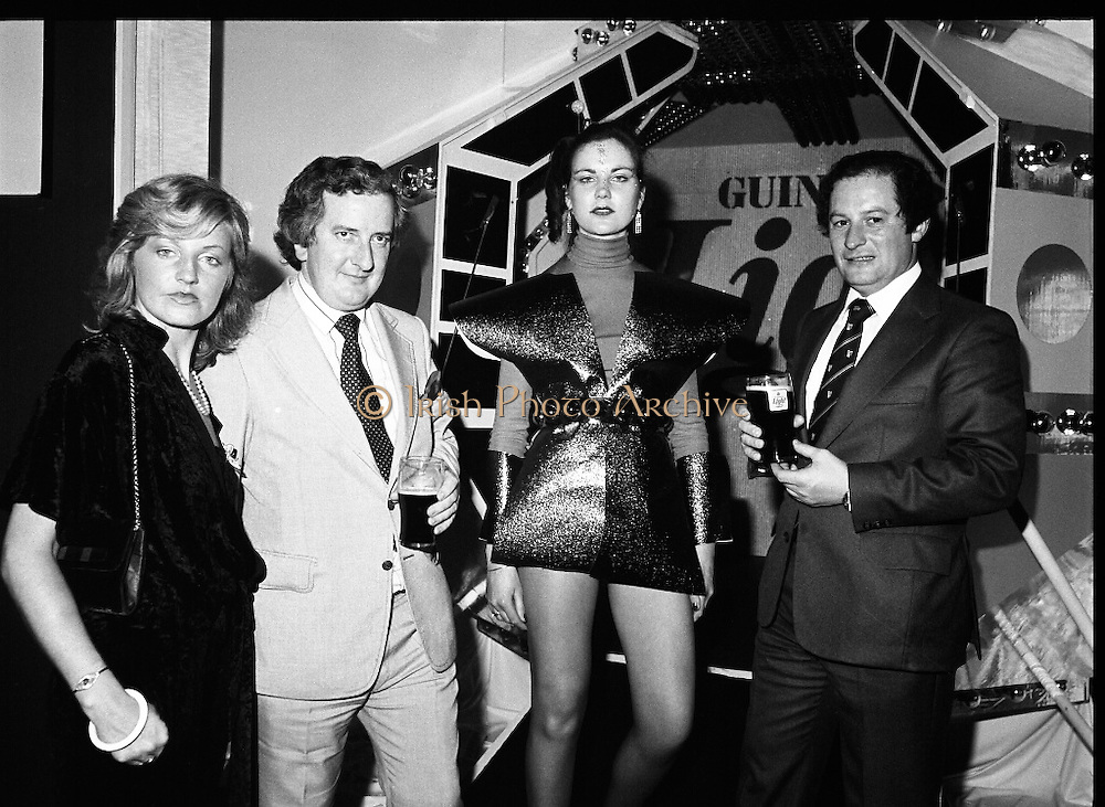 """Guinness Launch """"Guinness Light"""".  (M79)..1979..26.06.1979..06.26.1979..26th June 1979..At the Guinness Theatre in St James Gate Brewery,Guinness launched """"Guinness Light"""". With a spectacular show Guinness brought to the market a new lighter version of its world famous stout. it is hoped that it will fill a niche with younger drinkers frequenting Ireland's pubs and clubs..Image taken at the launch of the New Guinness Light Stout were Anne O'Doherty C.G.S.I., Jim Flannery. Chief Executive, Irish Hotels Federation, 'Space girl', Siobhan McCabe and Eric Wardrop, Area Sales Manager,Limerick."""