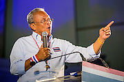 03 JANUARY 2014 - BANGKOK, THAILAND:  SUTHEP THAUGSUBAN speaks to anti-government protestors in Bangkok from a stage at Democracy Monument. Thousands of Thai anti-government protestors came to Democracy Monument in Bangkok Friday night to hear Suthep outline his plans to shut down the city of Bangkok. Suthep said his protestors would occupy 20 major intersections in the commercial sections of Bangkok for up to three weeks or until the caretaker government of Yingluck Shinawatra resigns.    PHOTO BY JACK KURTZ