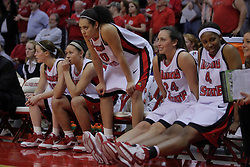29 March 2009: Redbirds on the bench are on the edges of their chairs during the final minutes of competition. The Hoosiers of Indiana fall to the Redbirds of Illinois State 66-55 during a Women's National Invitational quarterfinal game on Doug Collins Court inside Redbird Arena in Normal Illinois.