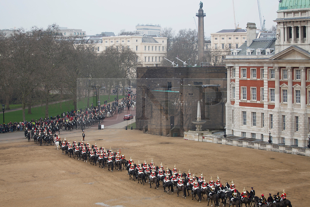 © licensed to London News Pictures. London, UK 22/03/2013. The Household Cavalry Mounted Regiment leaving Horse Guards Parade after the inspection of Major General George Norton CBE, Officer Commanding the Army in London and the Household Division, ahead of a busy summer of pageantry. Photo credit: Tolga Akmen/LNP