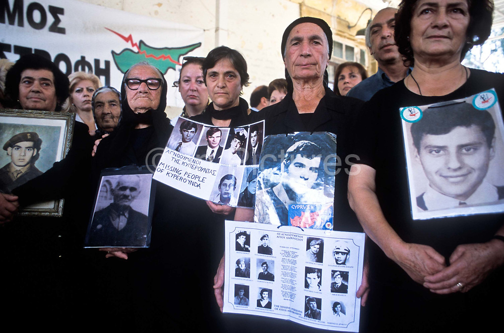 """Greek Cypriot mothers and wives known as """"the women of the Barricades"""" hold pictures of their loved ones, husbands and sons, whose deaths or disapperances they blame on Turkey. They congregate regularly at the border crossing between the divided Nicosia, Cyprus"""