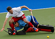 England's Simon Mantell (top) crashes into New Zealand's Devon Manchester during the shootout in the men's bronze medal field hockey match at the 2014 Commonwealth Games in Glasgow, Scotland, August 3, 2014. REUTERS/Jim Young