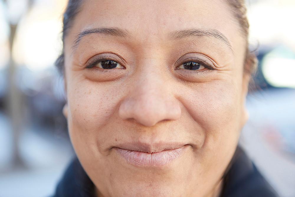 Closeup portrait photograph of smiling Mexican woman