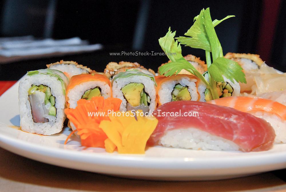 Assortment of Sushi on a platter including: Sushi Maki, futo maki, Insideout