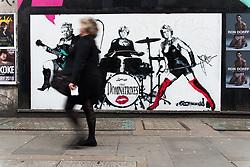 April 17, 2018 - London, United Kingdom - Pedestrians walk past a satirical piece by artist 'Loretto', featuring Queen Elizabeth II, German Chancellor Angela Merkel and British Prime Minister Theresa May, London on April 17, 2018  (Credit Image: © Alberto Pezzali/NurPhoto via ZUMA Press)