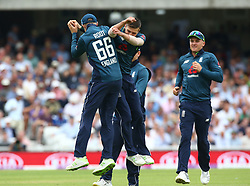 June 13, 2018 - London, England, United Kingdom - England's Mark Wood and England's Joe Root  celebrate the wicket of \a55\.during One Day International Series match between England and Australia at Kia Oval Ground, London, England on 13 June 2018. (Credit Image: © Kieran Galvin/NurPhoto via ZUMA Press)