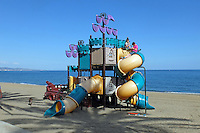 Children's slide, beach, San Pedro de Alcantara, Marbella, Spain, March, 2016, 201603062381<br /> <br /> Copyright Image from Victor Patterson, 54 Dorchester Park, Belfast, UK, BT9 6RJ<br /> <br /> t1: +44 28 9066 1296 (from Rep of Ireland 048 9066 1296)<br /> t2: +44 28 9002 2446 (from Rep of Ireland 048 9002 2446)<br /> m: +44 7802 353836<br /> <br /> e1: victorpatterson@me.com<br /> e2: victorpatterson@gmail.com<br /> <br /> The use of my copyright images is subject to my Terms & Conditions.<br /> <br /> It is IMPORTANT that you familiarise yourself with them. They are available on my website at www.victorpatterson.com.<br /> <br /> None of my copyright images may be used on a website unless they are visibly watermarked, i.e. © Victor Patterson within the body of the visible image. Metadata denoting my copyright must NOT be deleted. <br /> <br /> Web use is extra at currently recommended NUJ rates.