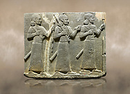 Photo of Hittite relief sculpted orthostat stone panel of Royal Buttress Basalt, Karkamıs, (Kargamıs), Carchemish (Karkemish), 900-700 B.C. Warriors. Anatolian Civilisations Museum, Ankara, Turkey.<br /> <br /> Three figures each with a long dress, a thick belt and curly hair. The figure in front holds a spear with a broken tip in his left hand and a leafy branch in his right hand. The figure in the middle made his left hand a fist, and he carries a tool with his right hand at the level of his head. They are followed with a figure holding a sceptre in his left hand. All three have each a long sword at their waist. <br /> <br /> Against a brown art background. .<br />  <br /> If you prefer to buy from our ALAMY STOCK LIBRARY page at https://www.alamy.com/portfolio/paul-williams-funkystock/hittite-art-antiquities.html  - Type  Karkamıs in LOWER SEARCH WITHIN GALLERY box. Refine search by adding background colour, place, museum etc.<br /> <br /> Visit our HITTITE PHOTO COLLECTIONS for more photos to download or buy as wall art prints https://funkystock.photoshelter.com/gallery-collection/The-Hittites-Art-Artefacts-Antiquities-Historic-Sites-Pictures-Images-of/C0000NUBSMhSc3Oo