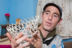 Wayne Bolley, nephew of the late Joyce Rose, a former tea lady at at the BBC who gave bosses the idea for Children In Need, displays one of his aunt's many tiaras that she wore when dressed up as The Queen. London, November 14 2018.
