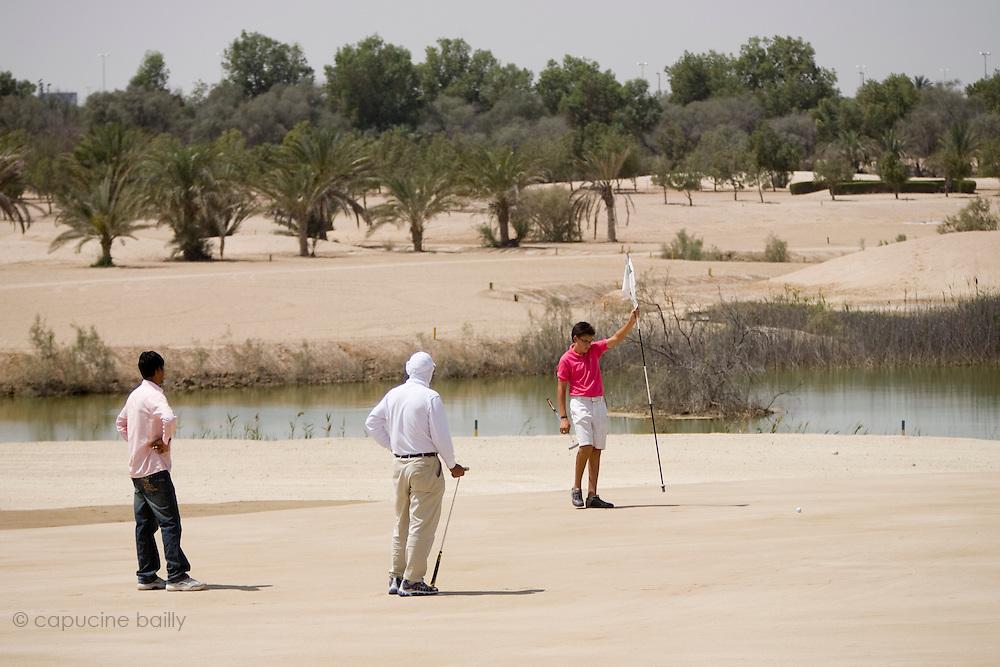 Abu Dhabi, United Arab Emirates (UAE). .March 20th 2009..Al Ghazal Golf Club..36th Abu Dhabi Men's Open Championship..Riad Majali (middle) and Bilel Belaid (right)