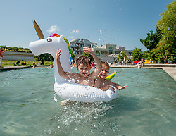 Alfie Hunter (5) and Solo Blyth (5) both from Edinburgh have fun in the ponds outside the Scottish Parliament, on what is predicted to be the hottest day of the year.<br /> <br /> © Dave Johnston / EEm
