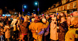 The Biggar Hogmanay bonfire lit at 9.30pm on Hogmanay by local resident Bobby Boyd MBE.  A large crowd celebrated in the HIgh Street.<br /> <br /> This is probably the biggest new year bonfire anywhere in the UK and continues a tradition going back hundreds of years.<br /> <br /> <br /> (c) Andrew Wilson | Edinburgh Elite media